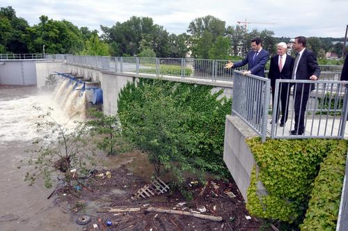 Ambassador Eisen, Fred Malek and Councillor Vaclav Novotny survey flood damage in Prague