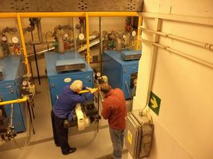 Facility management staff perform routine maintenance